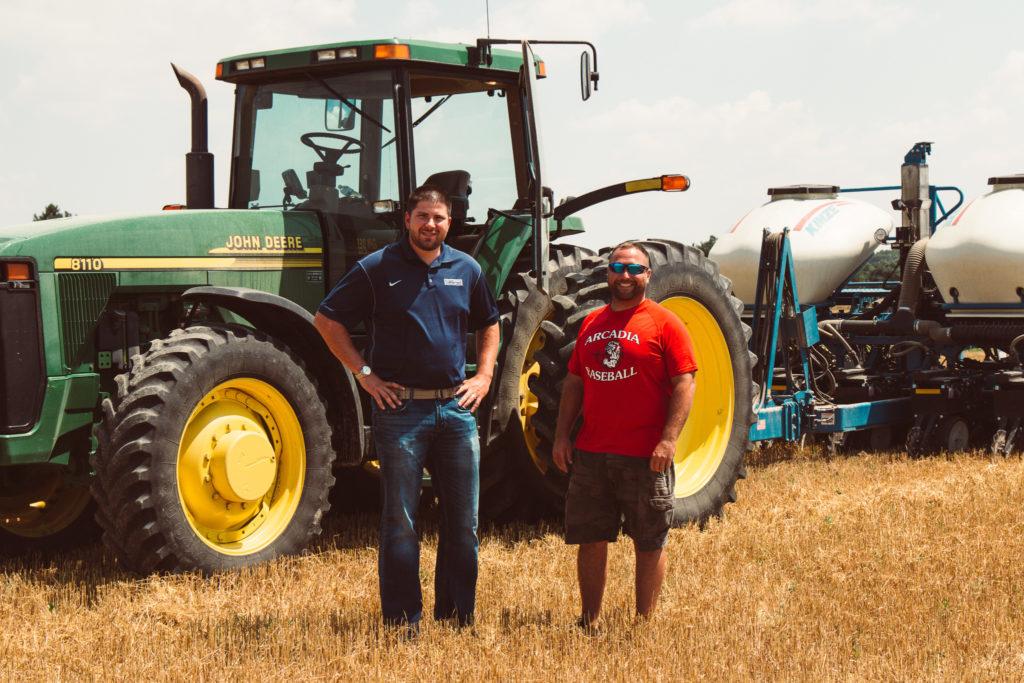 Ryan visiting farmer at the field